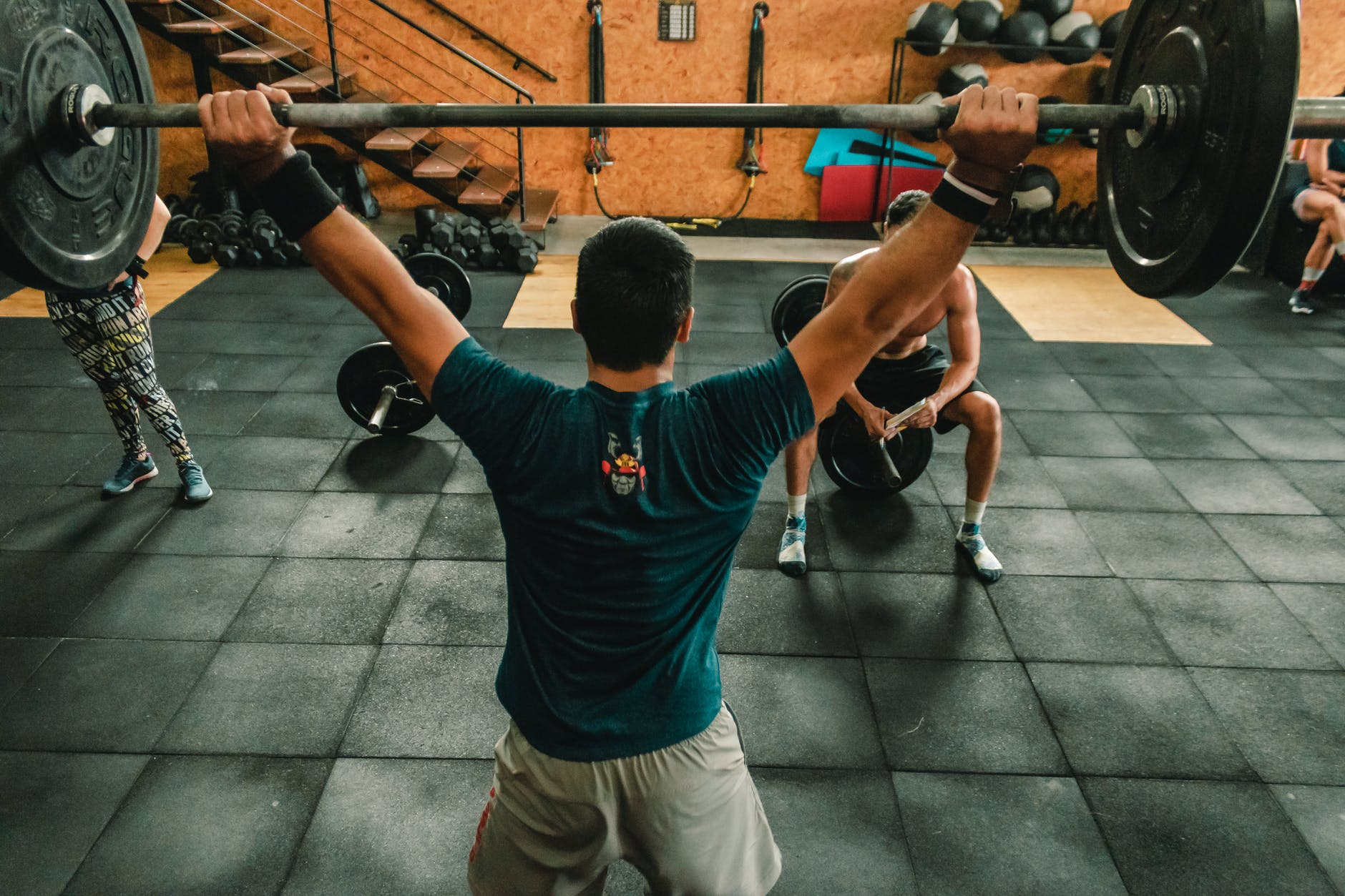 person lifting barbell indoors